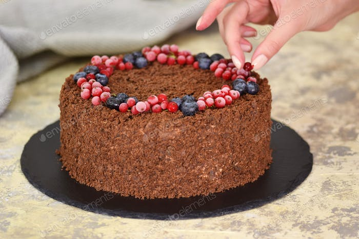 Russian Chocolate Cake Napoleon With Berries And Sprinkled With Crumbs. Decorating Cake with Berries