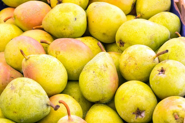 Yellow pears for sale at a market