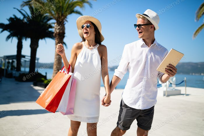 Couple on summer vacation enjoying travel and shopping