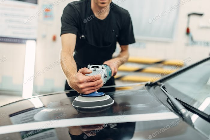 Male person prepares to restore the paint of car