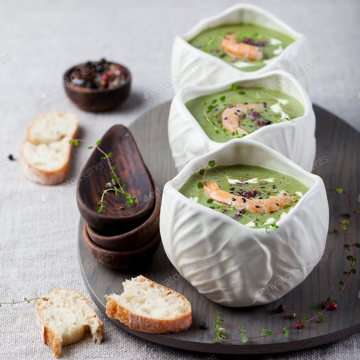 Broccoli, spinach cream soup, shrimp, wooden board