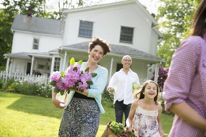 Family preparing a party in a garden.