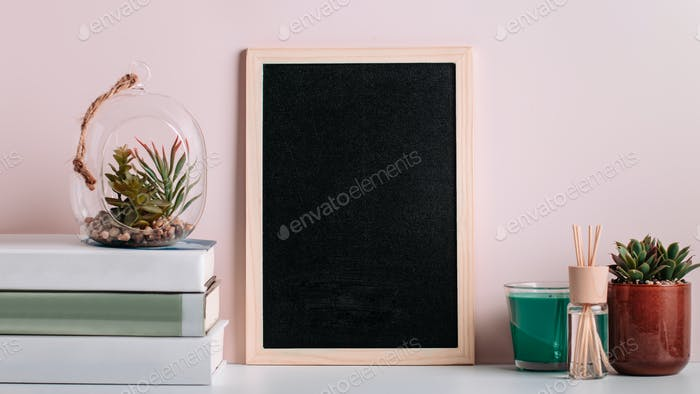 Bookshelf with multicolor books and blackboard