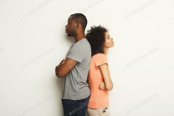 Break up, upset couple back to back after quarrel