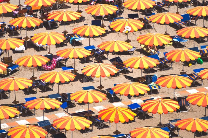 Detail of umbrellas on the beach on the Romagna coast in Italy