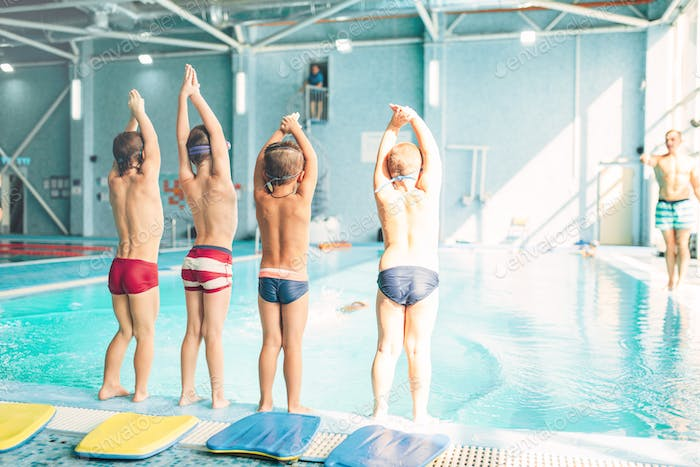 Boys doing sportive exercises with hands up