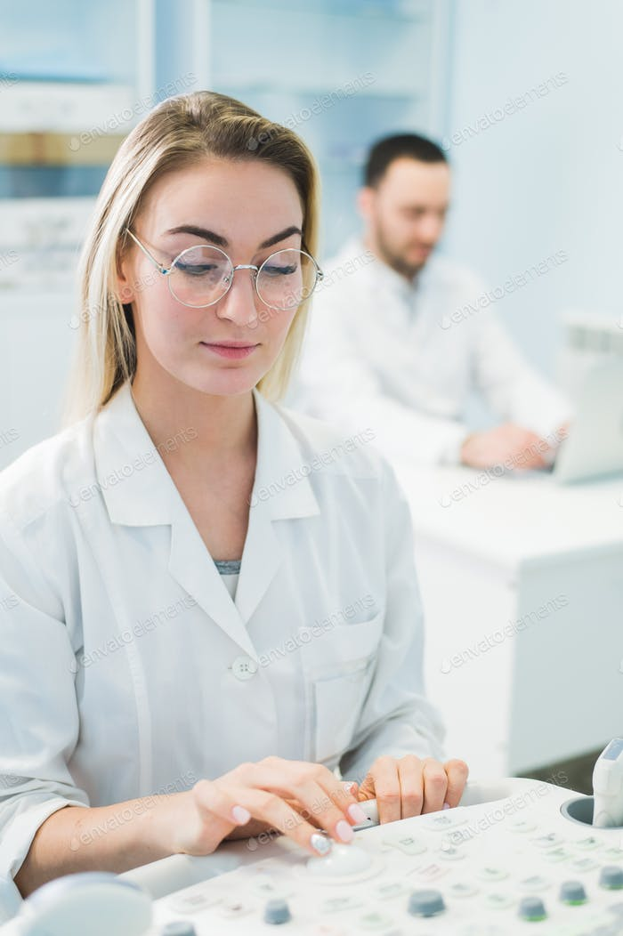 researchers team work at computer scientific analysing data out scientific test in chemistry