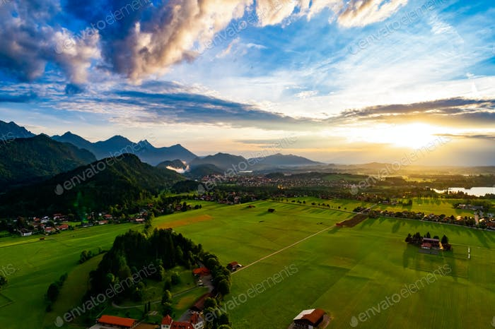 Panorama from the air sunset Forggensee and Schwangau, Germany,