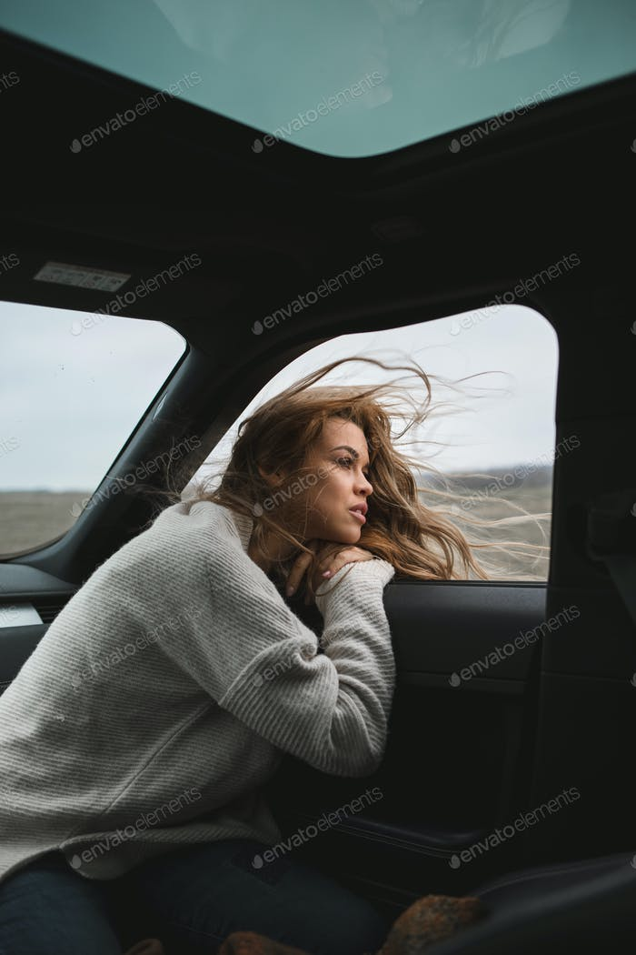 wonderful chilling girl travelling in the car
