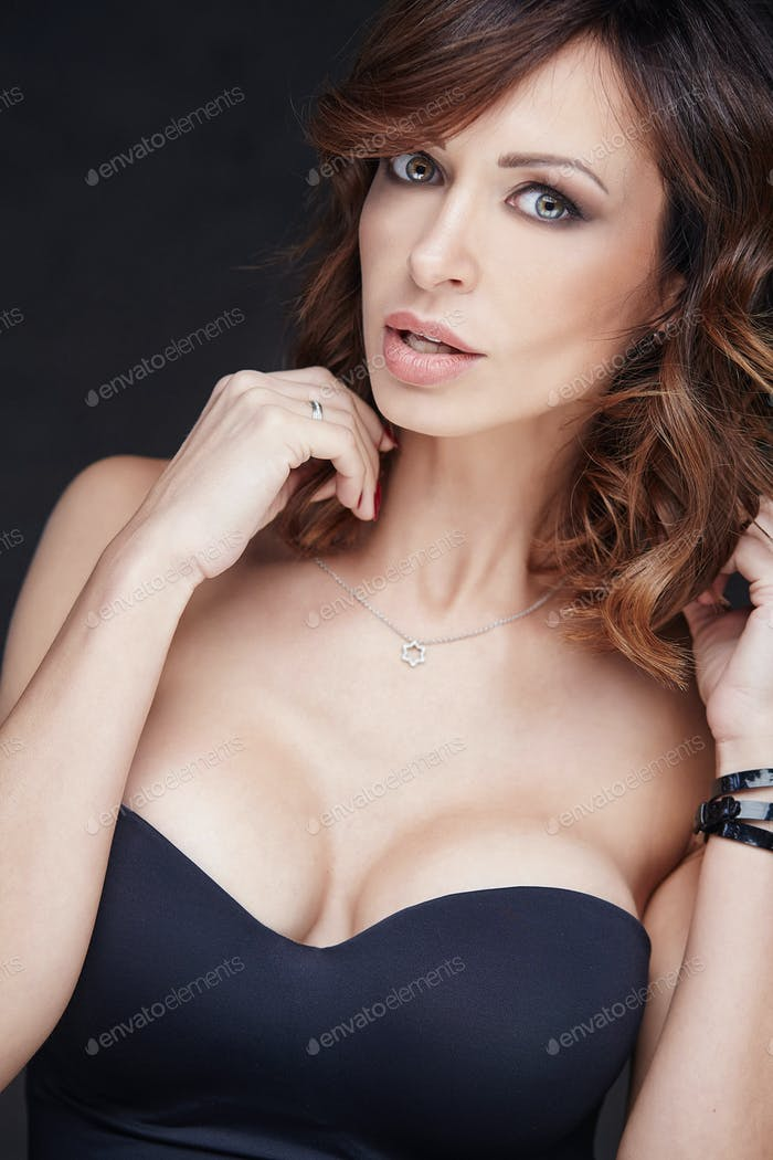 A woman in a black lingerie.