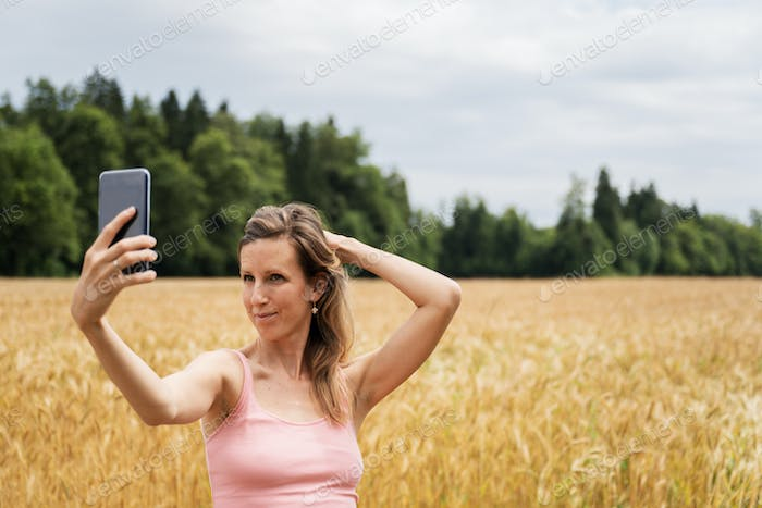 Young brunette making selfies