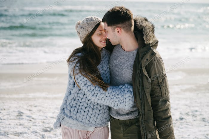 Happy Couple Embracing on Winter Sea Shore