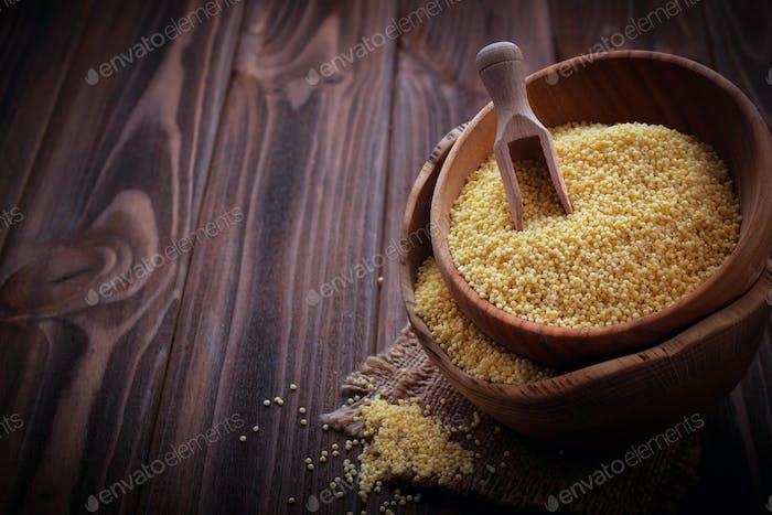 Millet in a wooden bowl