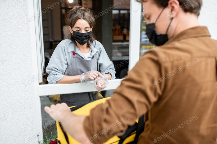 Courier taking an order for delivering from the shop window