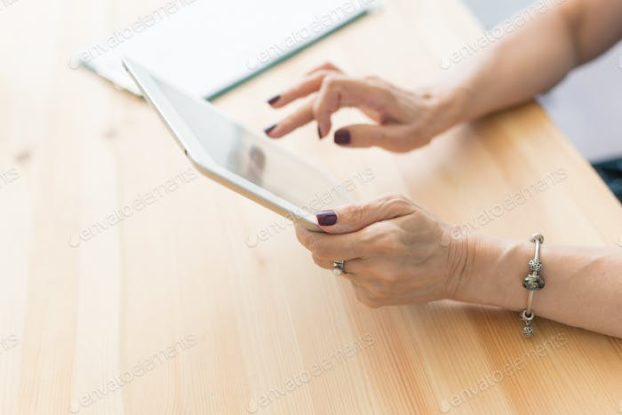 People and technologies concept - Close up of woman's hands holding digital tablet