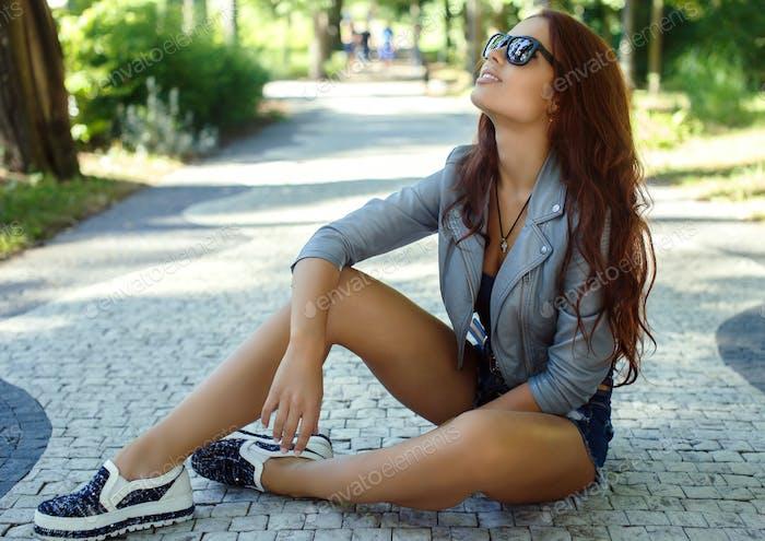 Sexy brunette girl in sunglasses.
