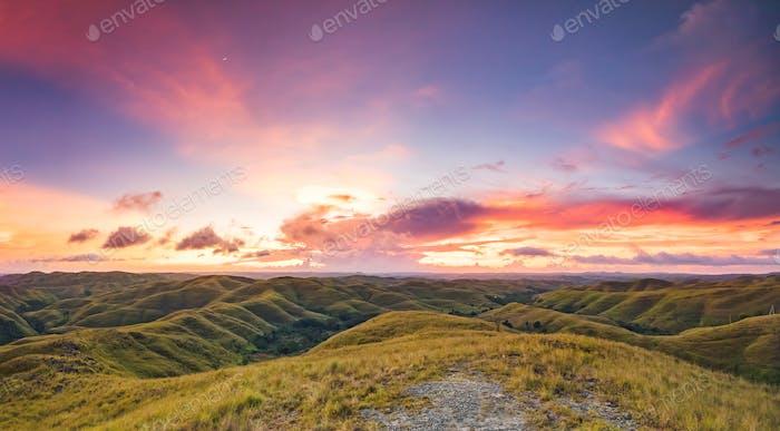 Grassland on the sunset sky background. Indonesia