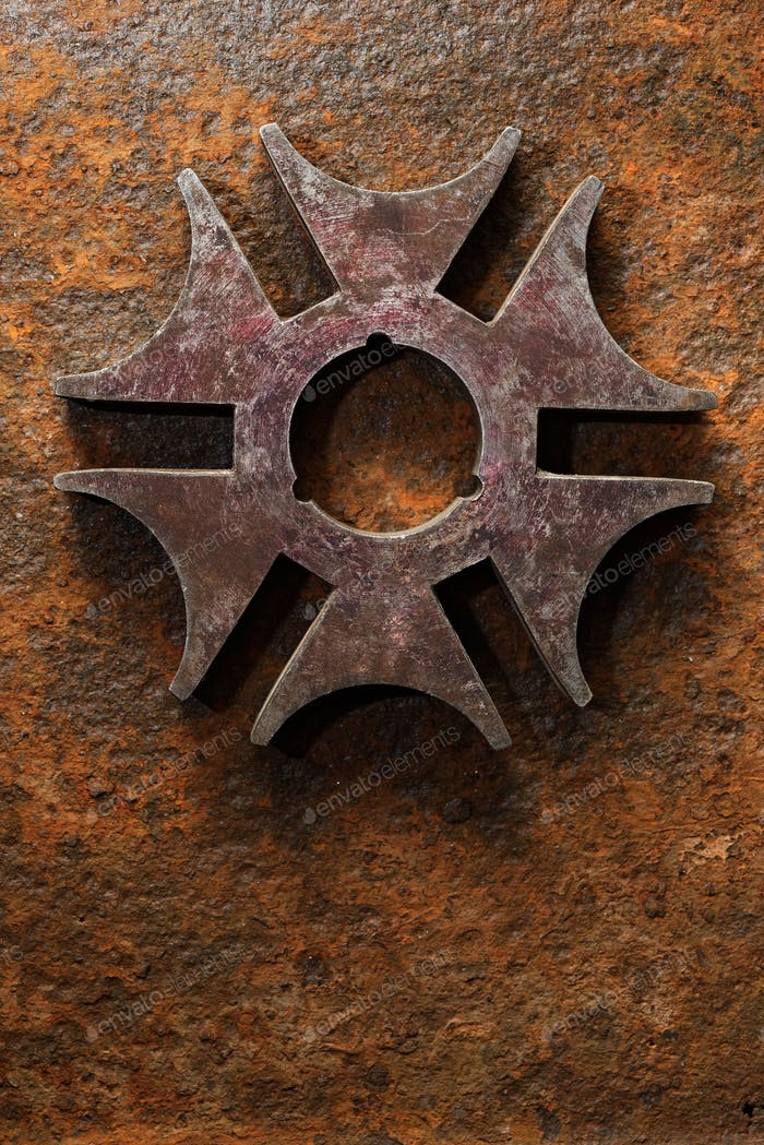 Rusty steel six-pointed star or cross