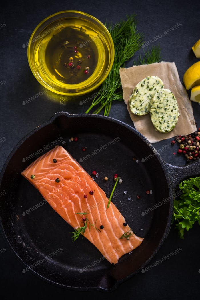 fresh salmon , herbs spices and rustic pan