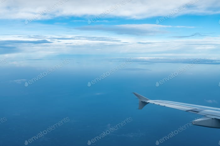 airplane wing view in the air, travel by plane