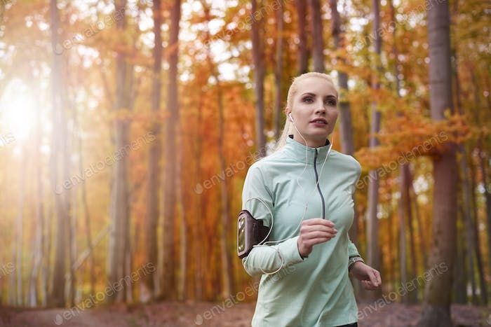 Fast running woman in the forest