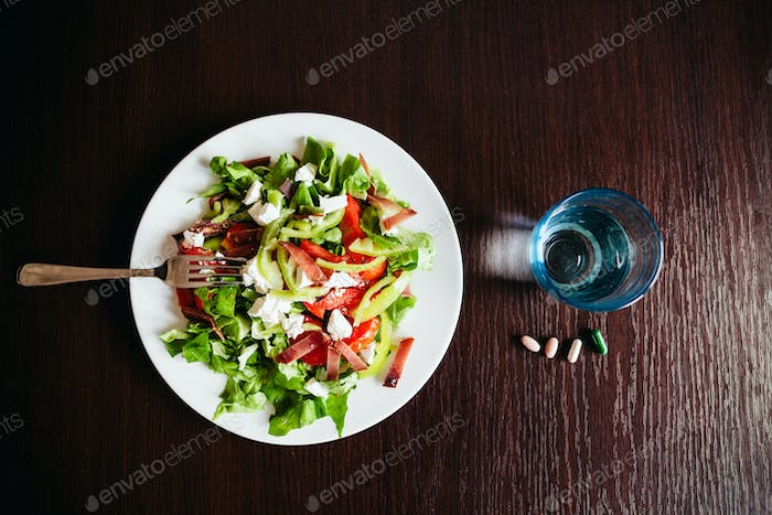 green salad with pills