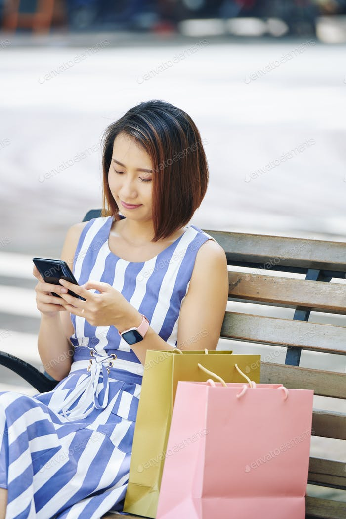 Woman with mobile phone outdoors