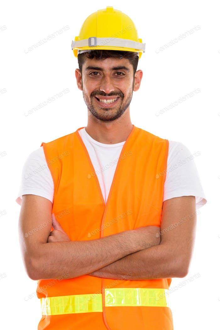 Young happy Persian man construction worker smiling with arms cr