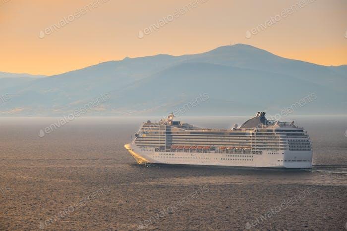 Cruise ship in Aegean sea on sunset