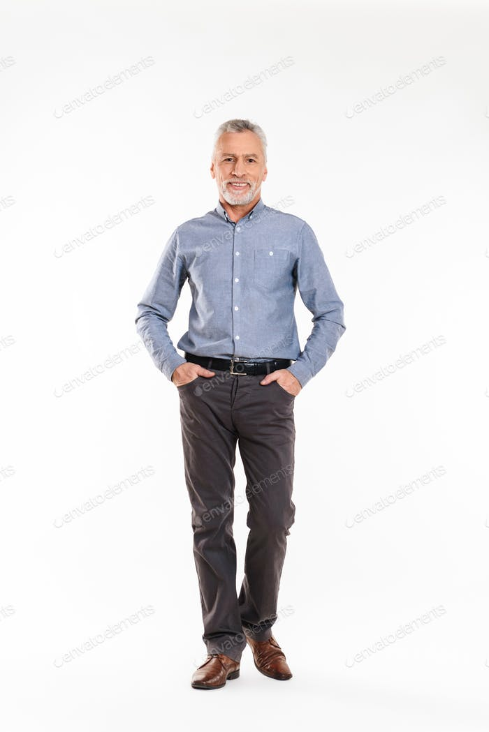 Positive old man looking camera and smiling over white