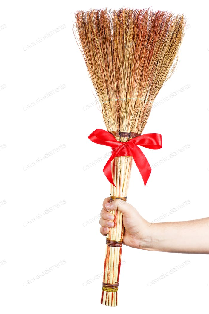 Hand hold new broom isolated on white background
