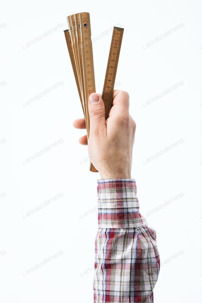 Hand holding a folding ruler