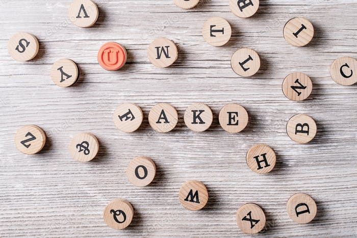 Word fake made from wooden letters