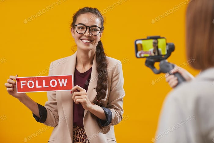 Contemporary Young Woman Holding Follow Word
