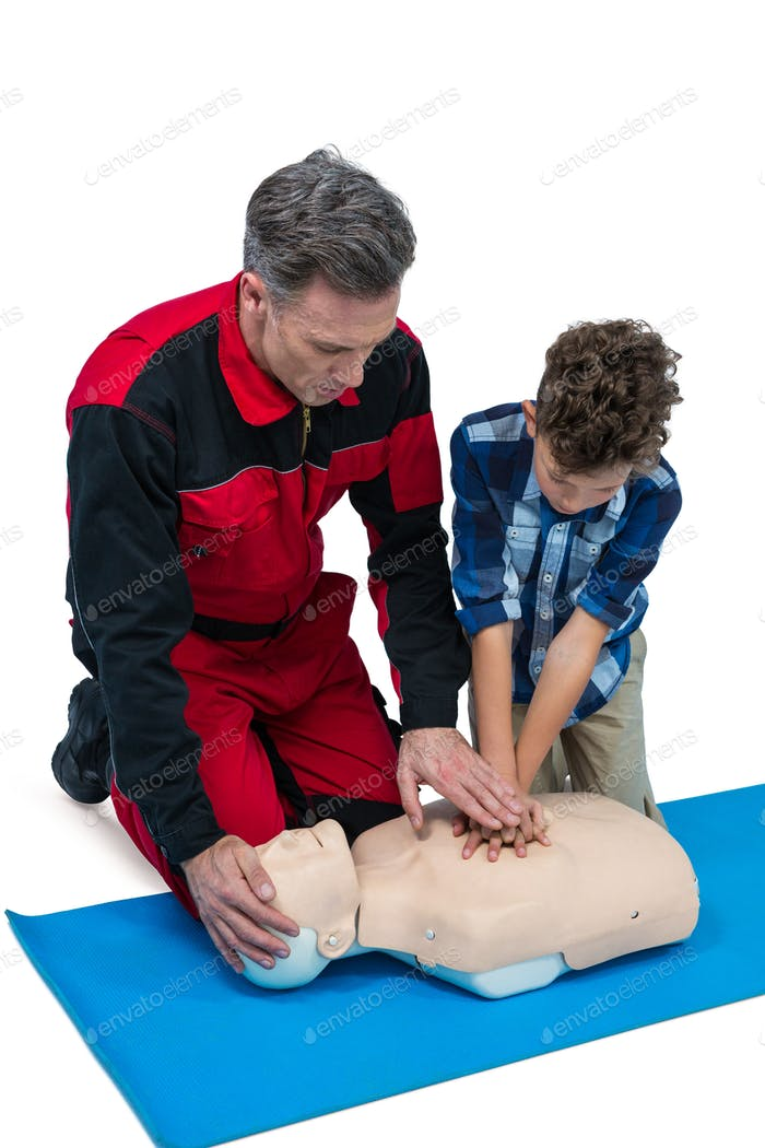 Paramedic training cardiopulmonary resuscitation to boy