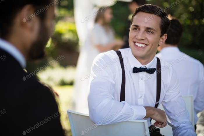 Waiter interacting with man in park