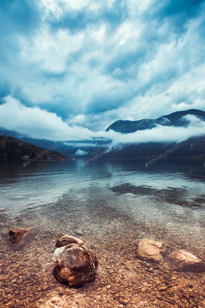Beautiful Bohinj lake landscape on cloudy autumn day