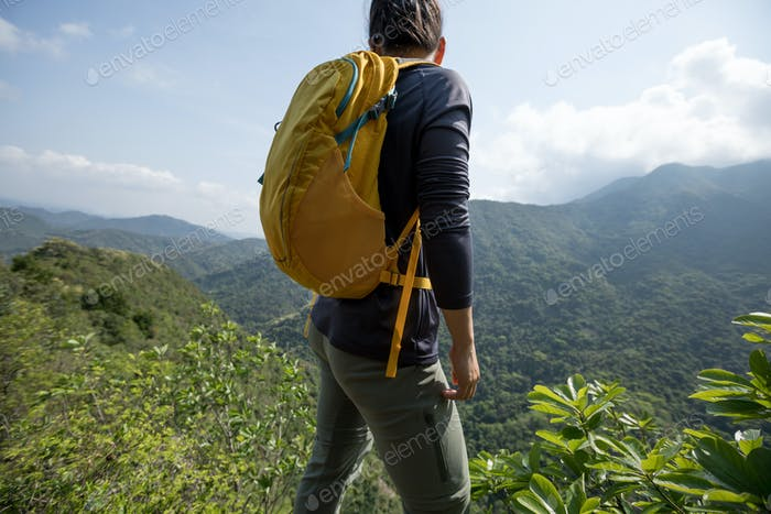 Successful hiker enjoy the view on mountain top