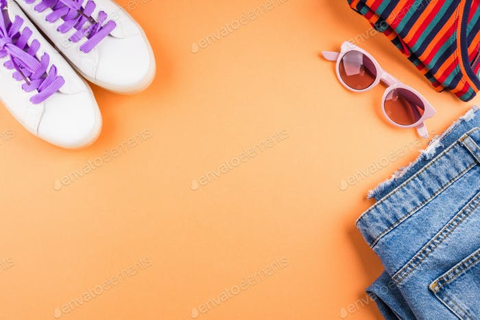 Fashion flat lay with jeans and sneakers