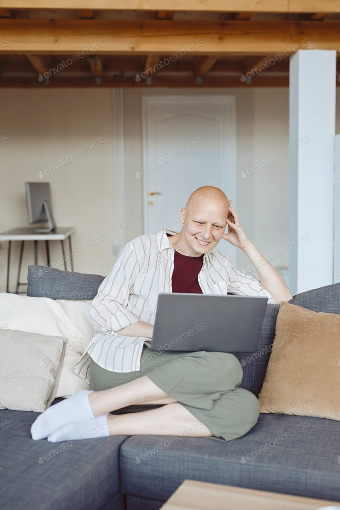 Contemporary Bald Woman Calling by Video Chat