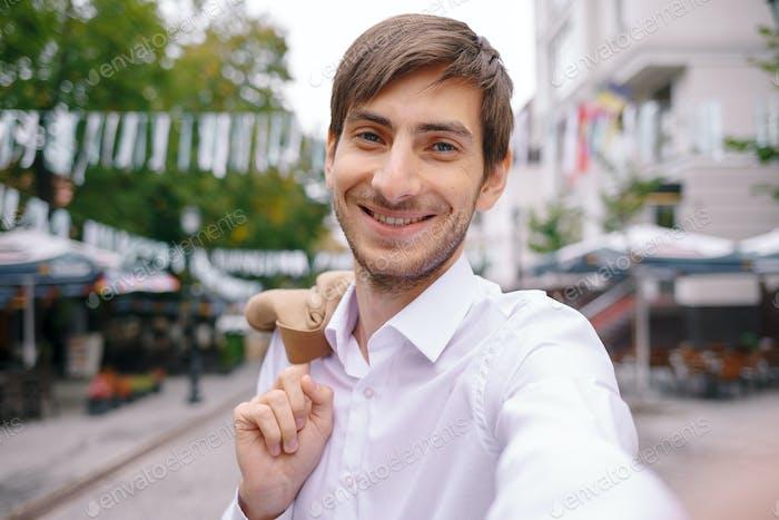 handsome man making a selfie