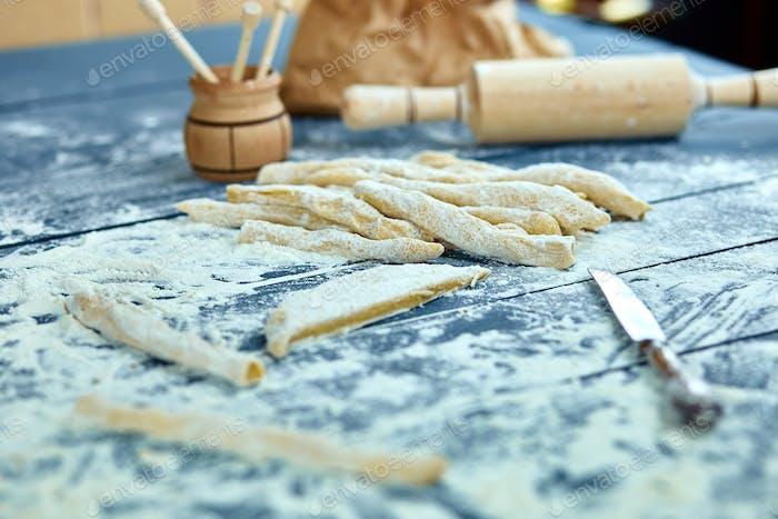 Closeup process making homemade pasta. Fresh dough