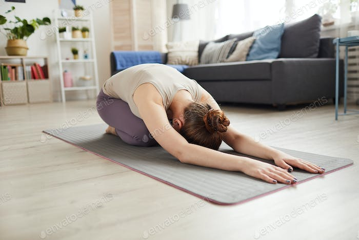 Woman doing relaxation exercise at home