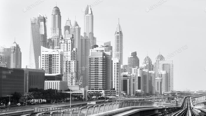 Old black and white film style picture of Dubai skyline.