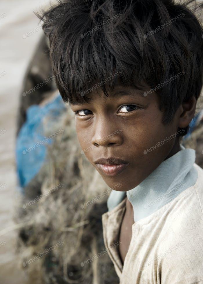 Native Boy Stricken By Poverty