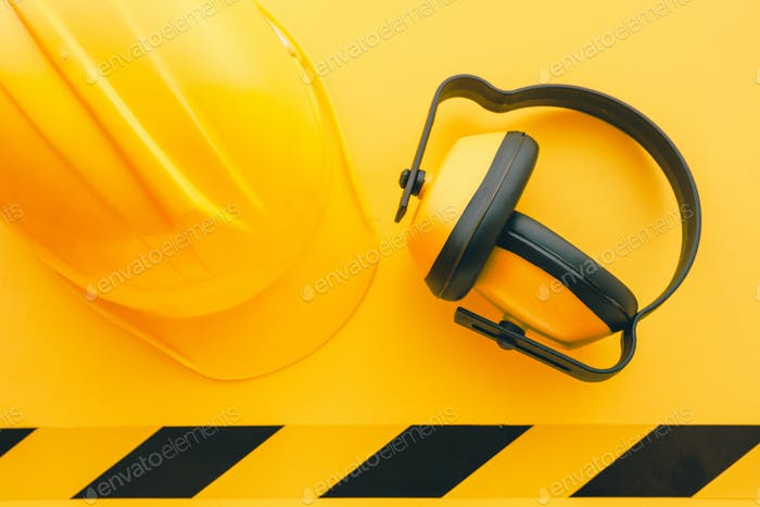 Protective construction helmet and earmuffs