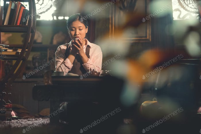 Young asian woman drinking tea