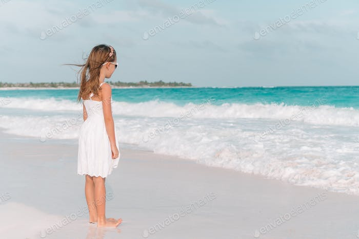 Cute little girl at beach during summer vacation