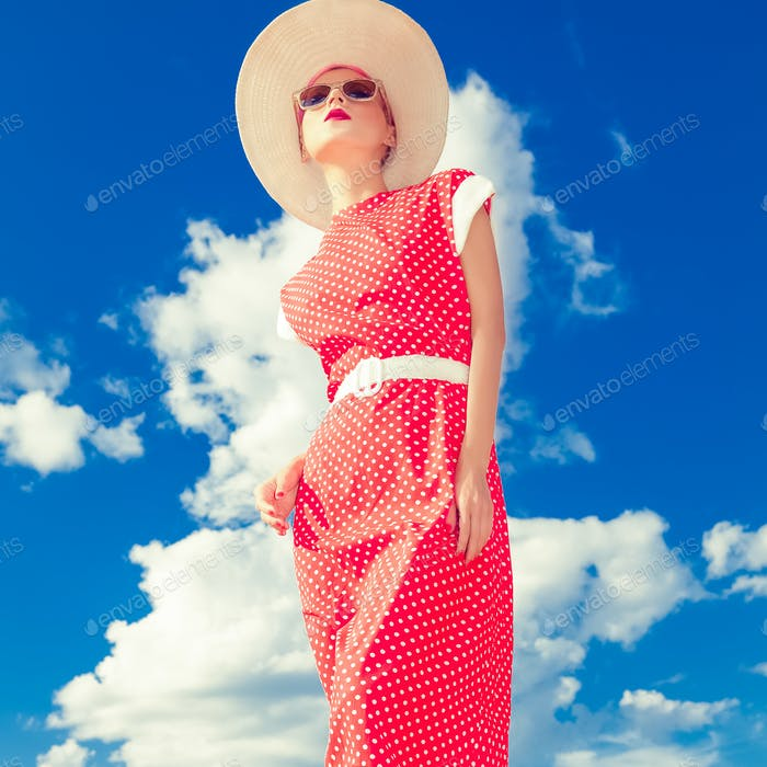 Fashion retro girl on the blue sky background