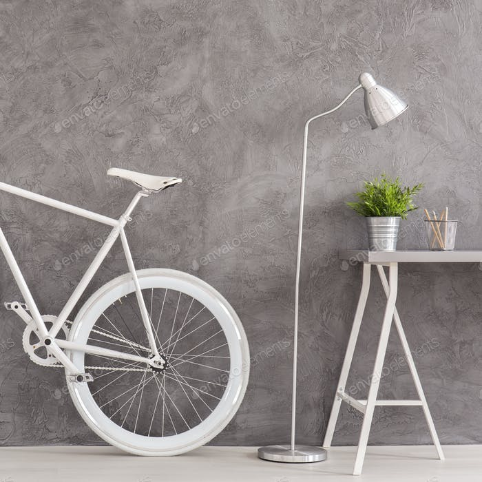 Grey interior with bike and desk
